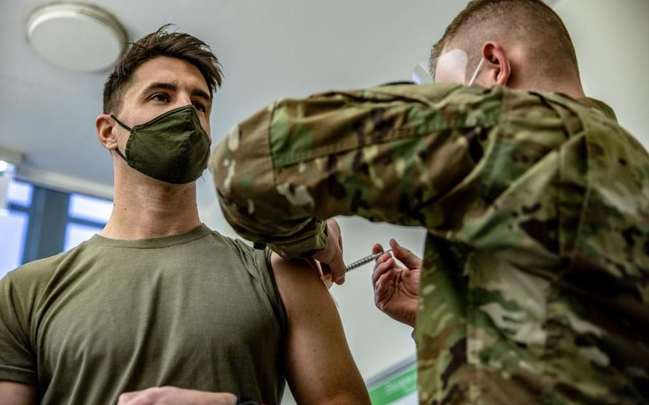 Capt. Skyler Brown, a family medicine physician assigned to the 173rd Airborne Brigade Combat Team, receives the Moderna COVID-19 vaccine from Pfc. Luca Webe at the U.S. Army Health Clinic in Grafenwoehr, Germany, on Dec. 28, 2020. Brown was the first servicemember in all of U.S. Army Europe and Africa to receive the vaccine, an Army official said.