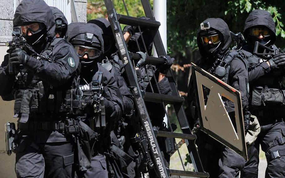 Two Iraqis who were detained in June by Poland's counter-terrorism and counter-intelligence service, the Internal Security Agency, or ABW, were charged with helping to fund the Islamic State terrorist group in a court in Wroclaw, in western Poland, Dec. 14, 2020.
