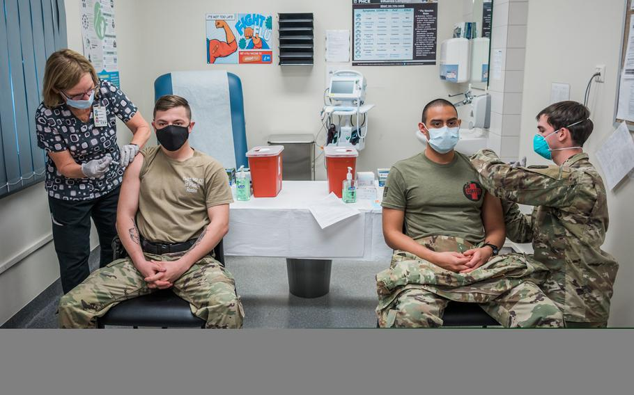 U.S. military personel receive the Moderna COVID-19 vaccine at the Wiesbaden, Germany clinic, Dec. 30, 2020. The U.S. military's campaign to vaccinate personnel in Europe against the coronavirus gathered steam this week as health care workers on the front lines of fighting COVID-19 were inoculated at bases in Germany and the United Kingdom.