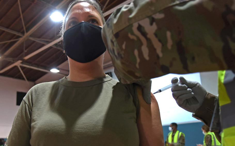 """Lt. Col. Melissa Simmons, human performance flight commander at Ramstein Air Base, Germany, receives the first dose of the Moderna COVID-19 vaccine on Monday, Jan. 4, 2021, at Ramstein. Simmons said the jab felt """"just like a flu shot."""""""