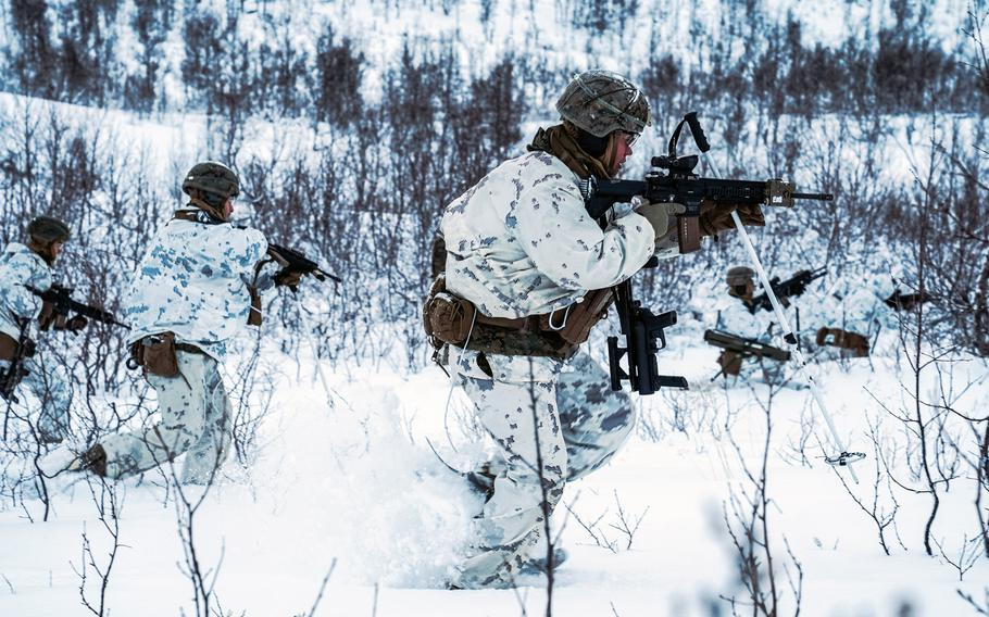 Marines with Marine Rotational Force-Europe 21.1, Marine Forces Europe and Africa, maneuver during a cold-weather live-fire training event in preparation for Exercise Reindeer II in Setermoen, Norway, Nov. 20, 2020. More than 1,000 Marines from Camp Lejeune, N.C., arrived in Norway in Jan. 2021 to build winter warfare skills.