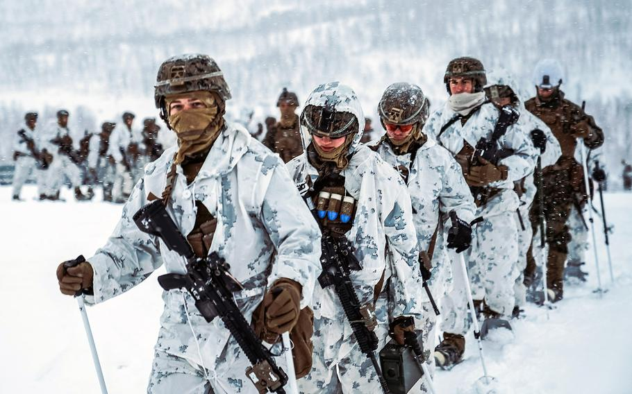In a Nov. 20, 2020 photo, Marines with Marine Rotational Force-Europe 21.1, Marine Forces Europe and Africa, hike through snow during a cold-weather live-fire training event in preparation for Exercise Reindeer II in Setermoen, Norway. More than 1,000 Marines from Camp Lejeune, N.C., arrived in Norway in Jan. 2021 to build winter warfare skills.