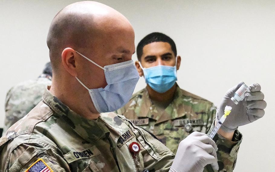 Maj. Sean O'Brien  of  U.S. Army Health Center Vicenza prepares the the garrison's first COVID-19 vaccine, Jan. 8, 2021 in Vicenza, Italy.