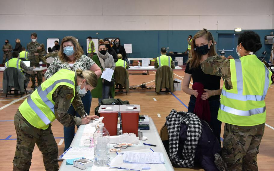 Two lines form at the COVID-19 shot clinic inside the Southside Fitness Center Annex at Ramstein Air Base, Germany. The base expected several hundred people for a walk-in shot clinic on Friday, Jan. 15, 2021.
