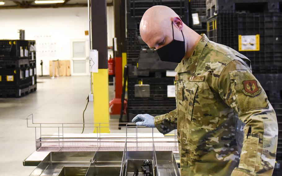 U.S. Air Force Tech. Sgt. Kyle Deconnick, 52nd Logistics Readiness Squadron, cleans an M4 rifle using an ultrasonic weapons cleaner at Spangdahlem Air Base, Germany, Nov. 9, 2020. Deconnick led the way to acquiring the machine to enhance the weapons cleaning process and save time.