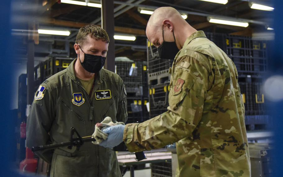 U.S. Air Force Tech. Sgt. Kyle Deconnick, 52nd Logistics Readiness Squadron, shows U.S. Air Force Col. David C. Epperson, 52nd Fighter Wing commander, an M4 rifle once it has been cleaned using an ultrasonic weapons cleaner at Spangdahlem Air Base, Germany, Nov. 9, 2020.