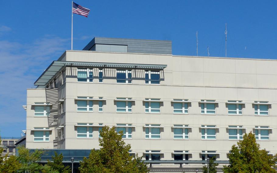 The American flag flies over the U.S. embassy in Berlin, Germany. The U.S. government has held talks with officials in Berlin to try to stop attempts by some German finance offices to collect income tax from American forces, a practice the military says violates an international treaty.