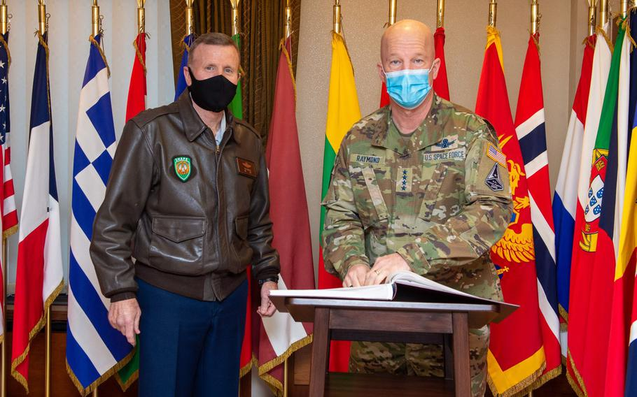 U.S. European Command's Tod D. Wolters meets with U.S. Chief of Space Operations Gen. John Raymond in Mons, Belgium, Feb. 1, 2021. Wolters said Wednesday, Feb. 3, that the previous administration's proposal to move 12,000 service members out of Germany will be reexamined.