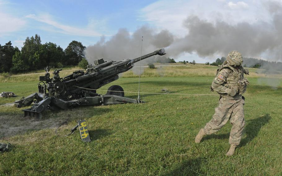 Pfc. Brent Rhodes, a cannon crew member with 2nd Cavalry Regiment, fires an M777A2 howitzer weapons system during an artillery demonstration at Grafenwoehr Training Area, Germany, in 2015. Gen. Christopher Cavoli, commander of U.S. Army Europe and Africa, says the U.S. needs more long-range artillery and other advanced weaponry in Europe.