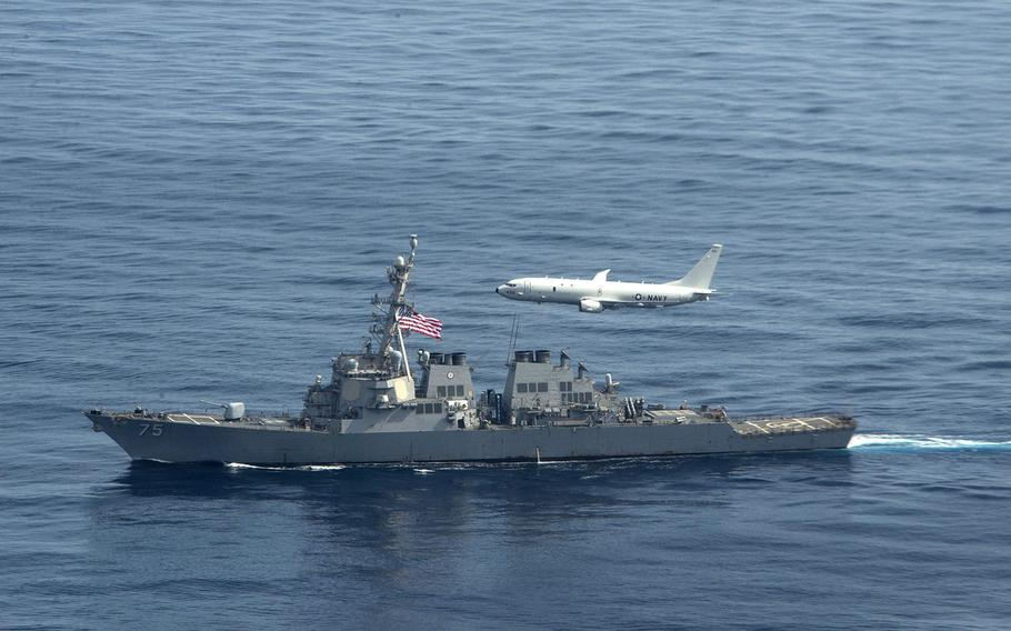A U.S. Navy P-8 Poseidon flies over the destroyer USS Donald Cook in the Black Sea in January 2021. Ukraine is planning two new naval bases in the region, Prime Minister Denys Shmyhal said at NATO headquarters in Brussels, Feb. 9, 2021.