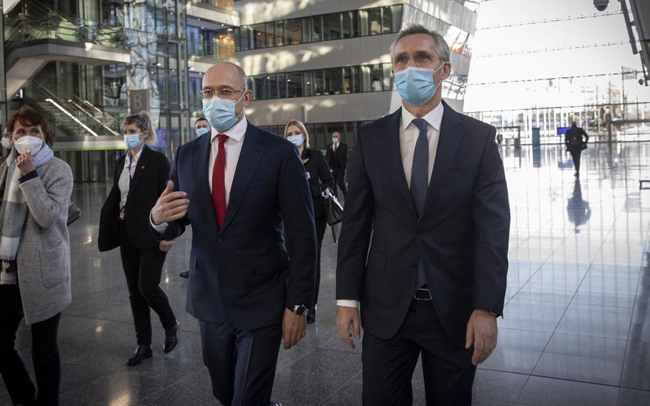 Ukrainian Prime Minister Denys Shmyha, left, meets with NATO Secretary-General Jens Stoltenberg at NATO headquarters in Brussels, Feb. 9, 2021. During the visit, Shmyhal said work will soon begin on two Ukrainian naval bases, one in the Black Sea and one in the nearby Sea of Azov.