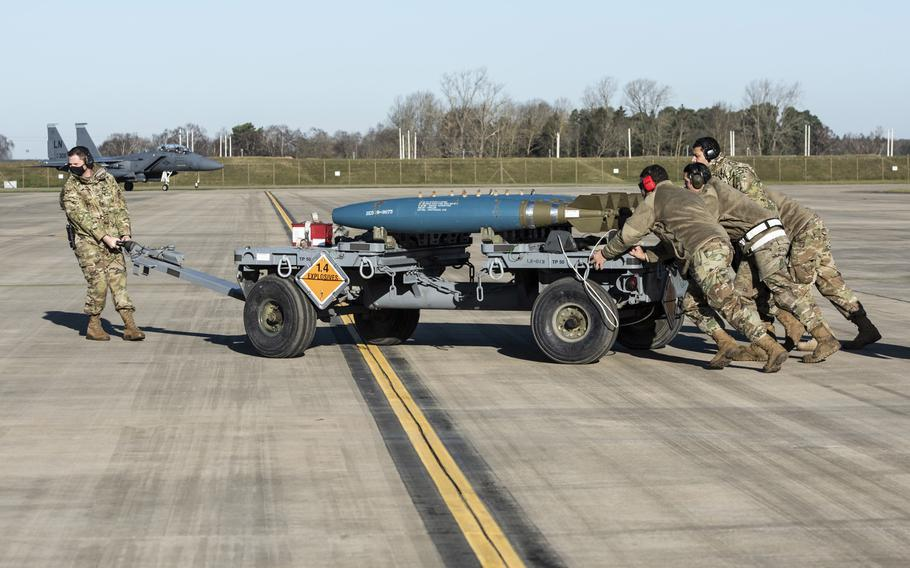 Airmen assigned to the 48th Aircraft Maintenance Squadron set up equipment during an exercise at RAF Lakenheath, England, Jan. 22, 2021. Starting March 1, 2021, the Air Force is extending overseas tour lengths from 24 to 36 months for unaccompanied airmen and Space Force members on their first permanent duty assignment at 22 of its bases in Europe and the Pacific.