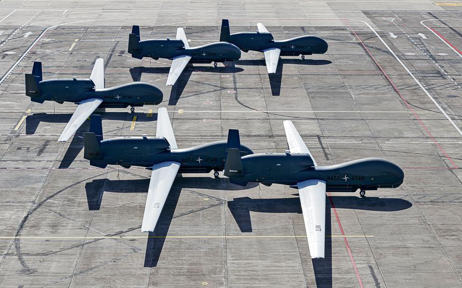 All five NATO AGS RQ-4D remotely piloted aircraft sit on the tarmac at Naval Air Station Sigonella, Italy.