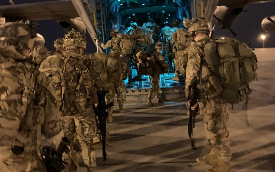 Paratroopers assigned to the 173rd Airborne Brigade, operating in support of the Combined Joint Task Force-Horn of Africa, East Africa Response Force, board a C-130J Hercules, Jan. 20, 2021, in Somalia.