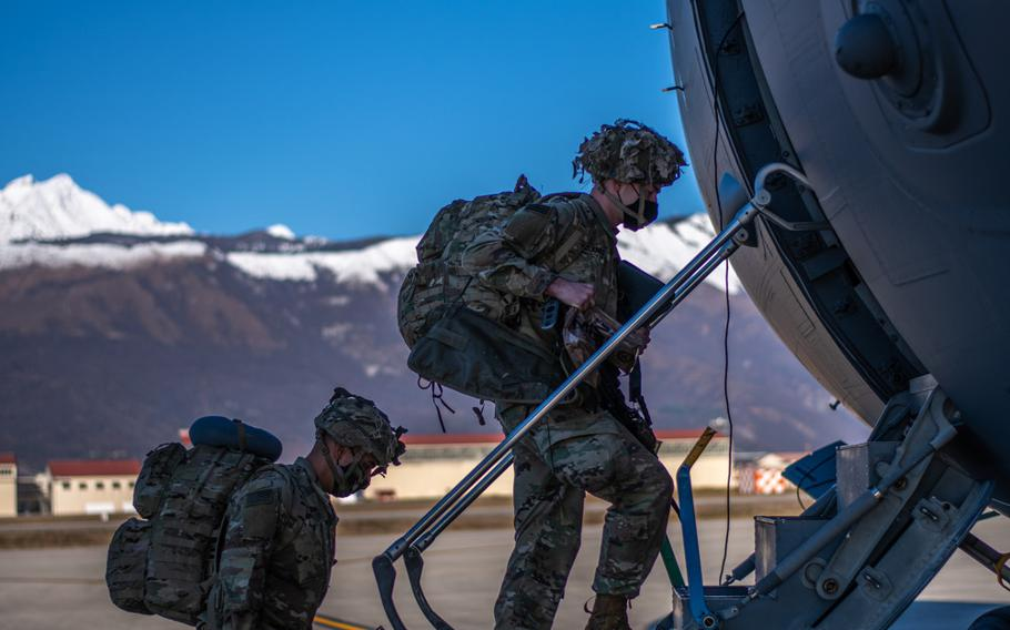 A paratrooper assigned to the 173rd Airborne Brigade boards a U.S. Air Force C-17 at Aviano Air Base, Italy, in preparation for movement to Camp Lemonnier, Djibouti, Dec. 14, 2020.