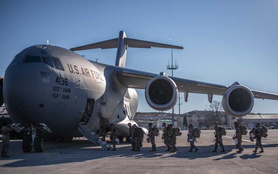 A paratrooper assigned to the 173rd Airborne Brigade boards a U.S. Air Force C-17 at Aviano Air Base, Italy in preparation for movement to Camp Lemonnier, Djibouti, Dec. 14, 2020.