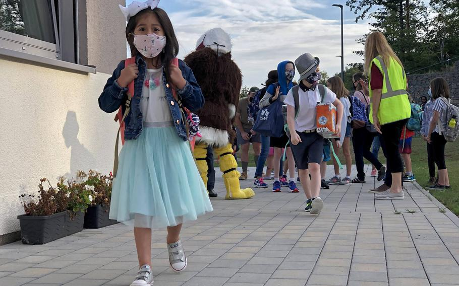 A student walks to class on the first day of school at Vogelweh Elementary School, Germany, Aug. 24, 2020. Students at most DODEA schools in Germany will return to class Monday, Feb. 22, 2021.