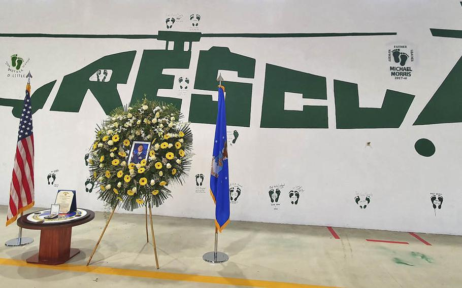 """The 56th Helicopter Maintenance Unit's rescue wall, with the """"Green Feet"""" dedication honoring fallen Tech. Sgt. Michael W. Morris, at Aviano Air Base, Italy, Feb. 19, 2021."""