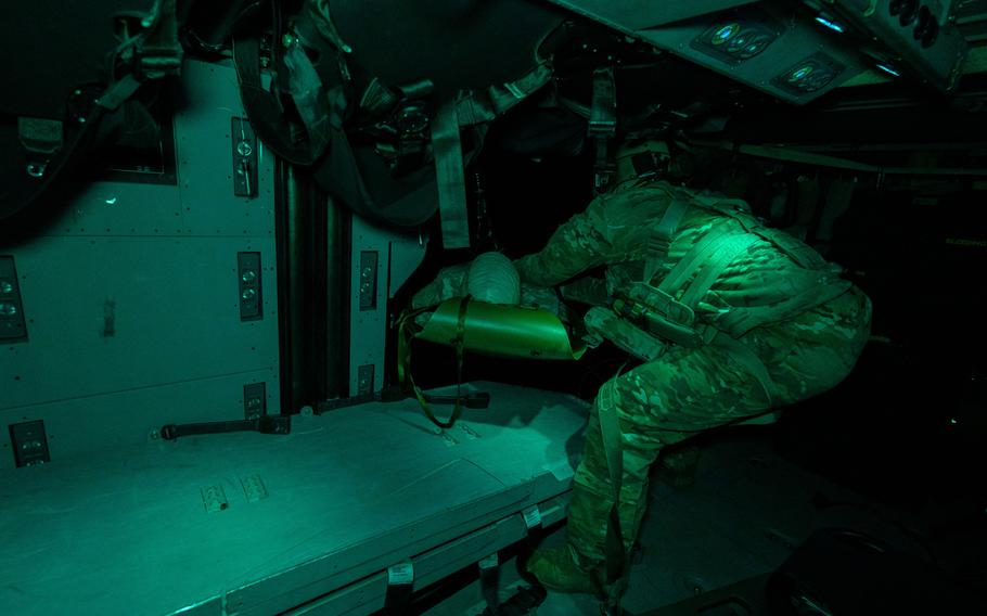 U.S. Army Sgt. Alexander Whitmore of the 101st Combat Aviation Brigade recovers a simulated casualty using the rescue hoist during Combined Resolve XV, Feb. 18, 2021, at Hohenfels Training Area, Germany.