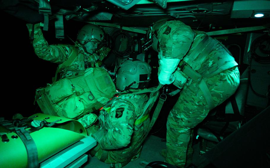 U.S. Army Sgt. 1st Class Marion Pettus, left, and Sgt. Alexander Whitmore, of Company C, 6th Battalion, 101st Combat Aviation Brigade, recover ''downed pilot'' Chief Warrant Officer3 Elliot Boyle using the rescue hoist during the Combined Resolve exercise on Feb. 18, 2021, at Hohenfels Training Area, Germany.