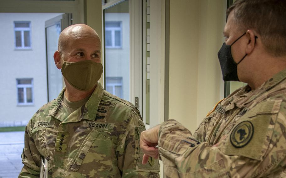Gen. Christopher Cavoli, U.S. Army Europe and Africa commander, left, meets with  Maj. Gen. William Gayler, U.S. Africa Command chief of staff, at AFRICOM headquarters  in Stuttgart, Germany, Nov. 24, 2020, to discuss how the merger of USAREUR and U.S. Army Africa will benefit partner engagements in Africa. Cavoli said on Feb. 23, 2021, that the consolidation of the two commands has led to significantly faster contingency response times on both continents.