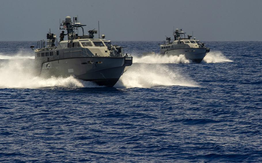 Two Mark VI patrol boats attached to Coastal Riverine Squadron 2 maneuver near Apra Harbor, Guam, in 2019. The Defense Department announced March 1, 2021, that two patrol boats are included in a $125 million military assistance package for Ukraine.
