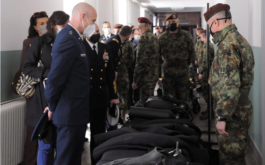 Maj. Gen. David Tabor, left, head of U.S. Special Operations Command Europe, looks at diving equipment during a visit to Serbia this week.