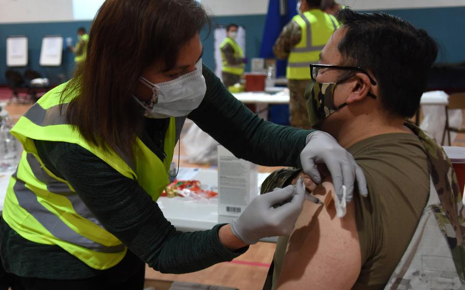Sarah Lewis, a registered nurse with the 86th Medical Group, vaccinates group commander Col. Ryan Mihata against COVID-19 at Ramstein Air Base, Germany, in January 2021. Vaccination campaigns for the U.S. military and their families in Europe have slowed as supplies dwindle and new deliveries are delayed.