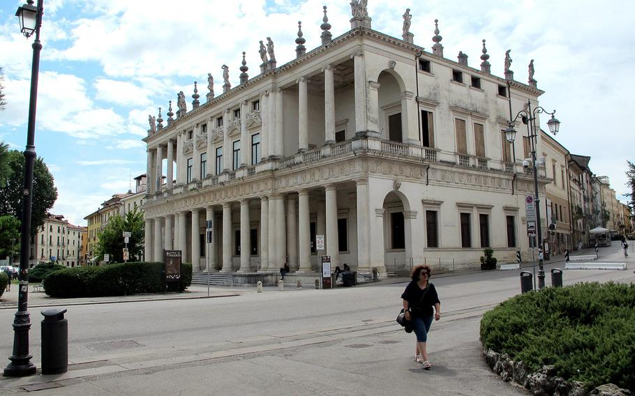 A woman walks near the Palazzo Chiericati Vicenza's municipal art museum. The region that includes Vicenza's U.S. Army Garrison Italy will be declared a red zone Monday by the national government, which would mandate tougher coronavirus restrictions.