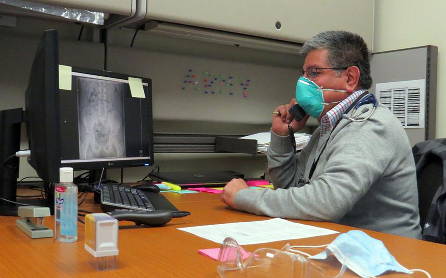 Dr. Rafael Nunez, a pediatrician at the U.S. Army Health Center in Vicenza, Italy, speaks on the phone March 9, 2021, with a parent about their child's diagnosis. Virtual appointments have been routine during the coronavirus pandemic.
