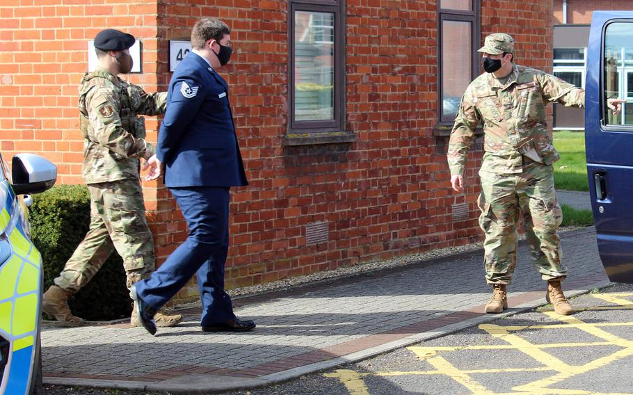 Tech. Sgt. Garret Souders is escorted following his court-martial at RAF Mildenhall, England, March 25, 2021. Souders was sentenced by a military judge to nine years in prison after being found guilty of charges related to possession and viewing of child pornography.