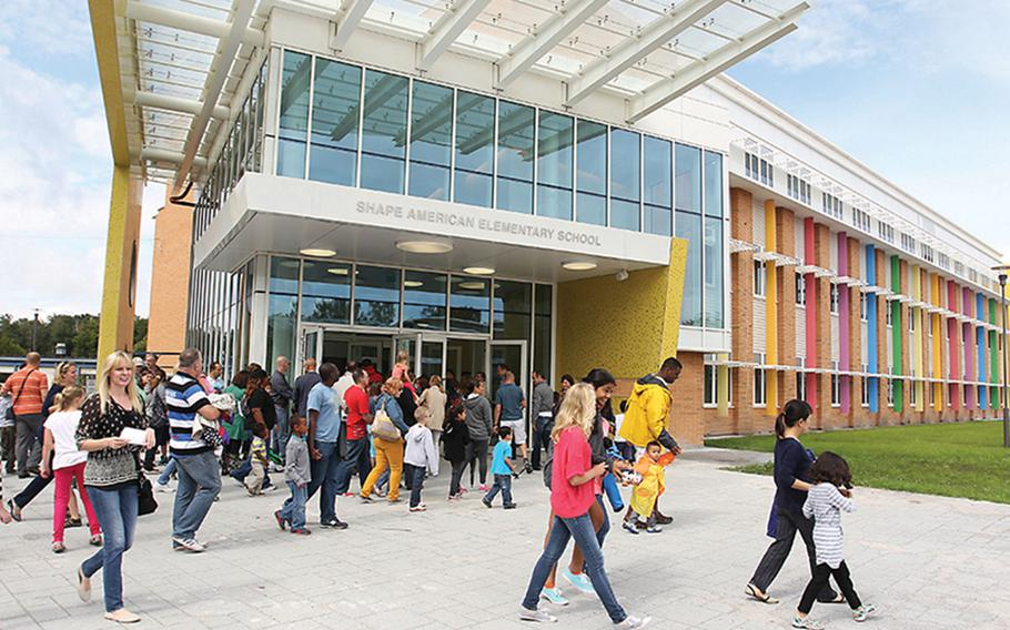 Visitors arrive at a SHAPE Elementary and Middle School open house in Mons, Belgium, in 2014. Some Department of Defense Education Activity schools in Belgium will go to remote learning starting March 29, 2021, following Belgium's decision to close schools and restrict nonessential business after an increase in coronavirus cases, school officials announced March 26.