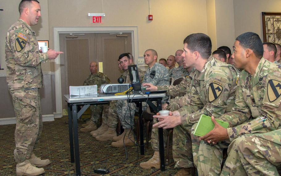 Then-Lt. Col. Michael Schoenfeldt, commander, 2nd Battalion, 5th Cavalry Regiment, 1st Armored Brigade Combat Team, 1st Cavalry Division, leads a discussion on hazing during the 1st ABCT Sexual Harassment/Assault Response Prevention conference at Club Hood, Texas in 2016. Schoenfeldt is under investigation after allegations of toxic leadership and violating coronavirus quarantine rules while commander of the brigade.
