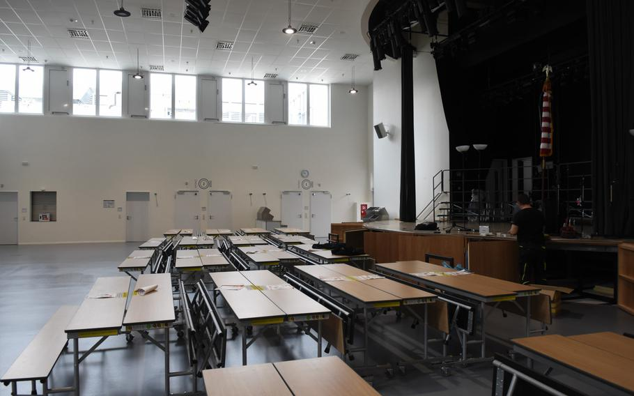 A room with a stage and acoustic sound boards on the walls doubles as a performance hall and cafeteria in the new Kaiserslautern Elementary School at Kapaun Air Station in Kaiserslautern, Germany. The building is slated to open Monday.
