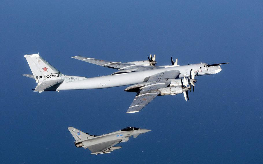 A Russian Tu-95 Bear aircraft is escorted by a U.K. Royal Air Force Typhoon during an intercept in September 2014. NATO fighter jets scrambled 10 times on Monday, March 29, 2021, to shadow Russian bombers and fighters over the North Atlantic, North Sea, Black Sea and Baltic Sea.