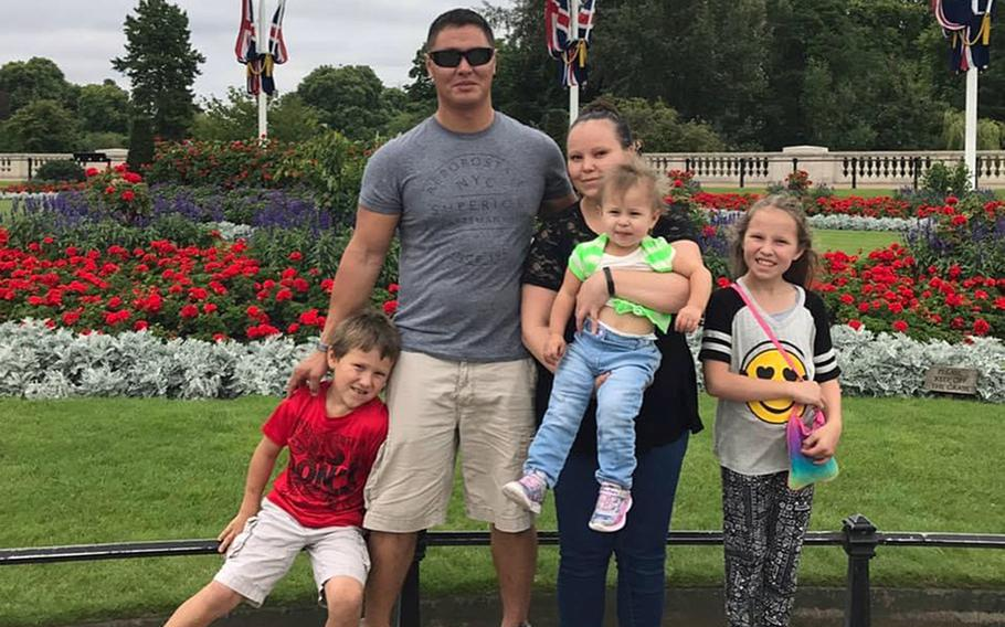 Tech. Sgt. Michael W. Morris with wife Amanda, and children Brayden, Matehya and Makenna in England. An autopsy conducted by Italian authorities concluded that Morris' death on Jan. 12, 2021, was due to COVID-19 complications, Aviano Air Base officials said.