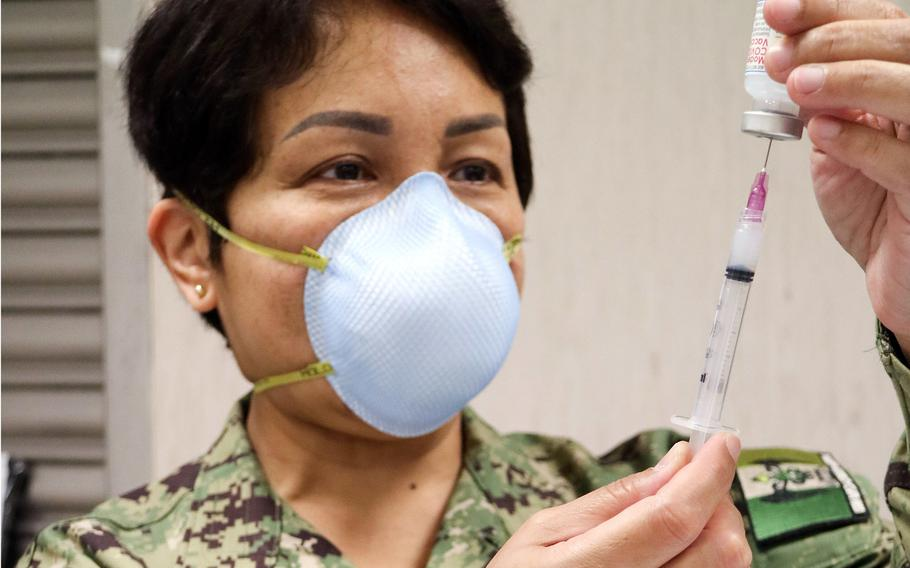Lt. Cmdr. Kathleen Bautista, a nurse at U.S. Naval Hospital Naples, prepares a syringe with the Moderna COVID-19 vaccine in Naples, Italy, in February 2021. Naples has vaccinated at higher rates than much of the U.S. military community in Europe, which has suffered from vaccine shortages.