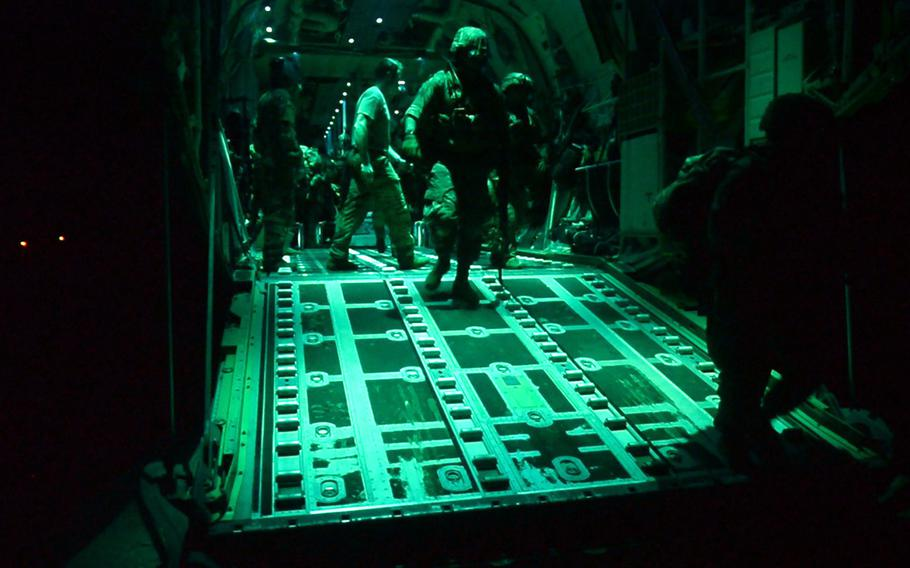 U.S. Army soldiers, assigned to the East Africa Response Force, 101st Airborne Division, exit a C-130J Super Hercules, at Manda Bay Airfield, Kenya, on Jan. 5, 2020. Defense Secretary Lloyd Austin has ordered an independent review of the attack that day by militants that killed three Americans and wounded at least three others at the small U.S. base.