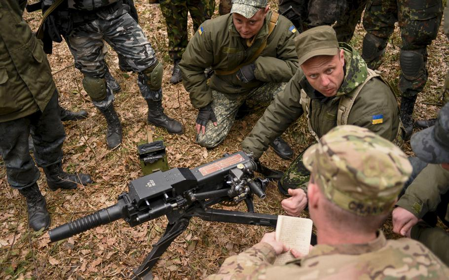 Ukrainian soldiers go over basic weapons procedures with a soldier from the 173rd Airborne Brigade in April 2015, during training in Yavoriv, Ukraine. A rapid Russian military buildup along the Ukrainian border in recent weeks has sparked fears of an invasion.