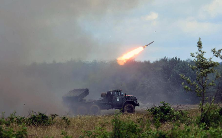 A Ukrainian BM-21 Grad Multiple Rocket Launcher fires a rocket during a training exercise in Yavoriv, Ukraine, in June 2017. A rapid Russian military buildup along the Ukrainian border in recent weeks has sparked fears of an invasion.