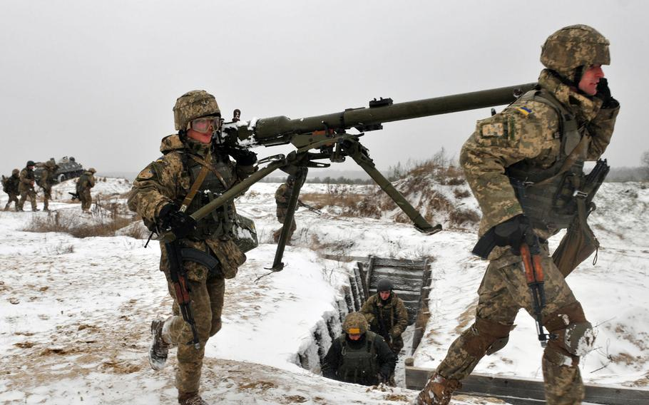 Ukrainian soldiers carry a recoilless rifle during a training exercise led by troops from the 2nd Infantry Brigade Combat Team, 3rd Infantry Division, in November 2016 at a range near Yavoriv, Ukraine. A rapid Russian military buildup along the Ukrainian border in recent weeks has sparked fears of an invasion.