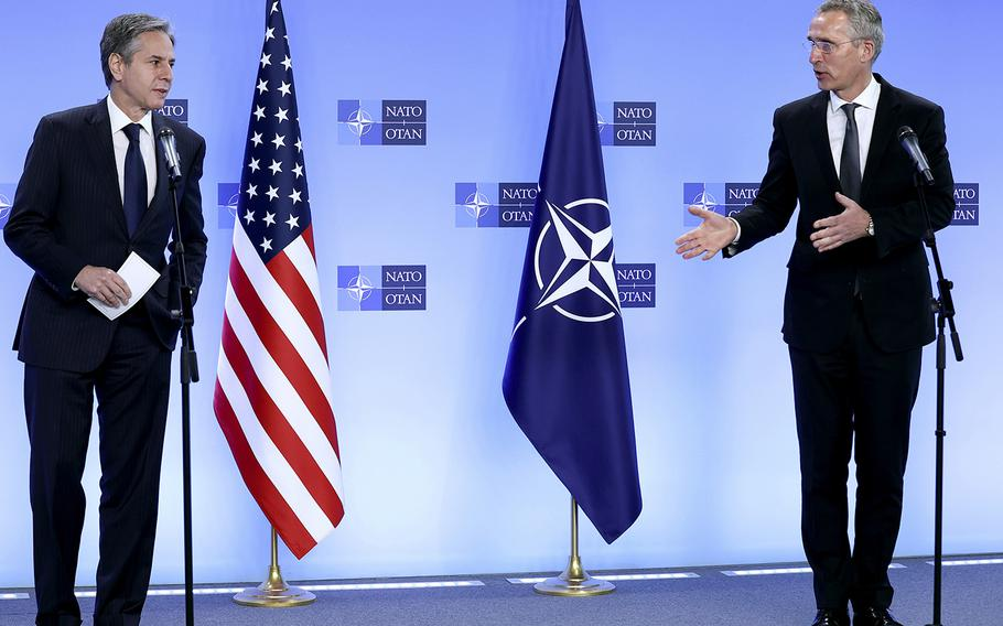 NATO Secretary General Jens Stoltenberg, right, and United States Secretary of State Antony Blinken address a media conference at NATO headquarters in Brussels, Wednesday, April 14, 2021.