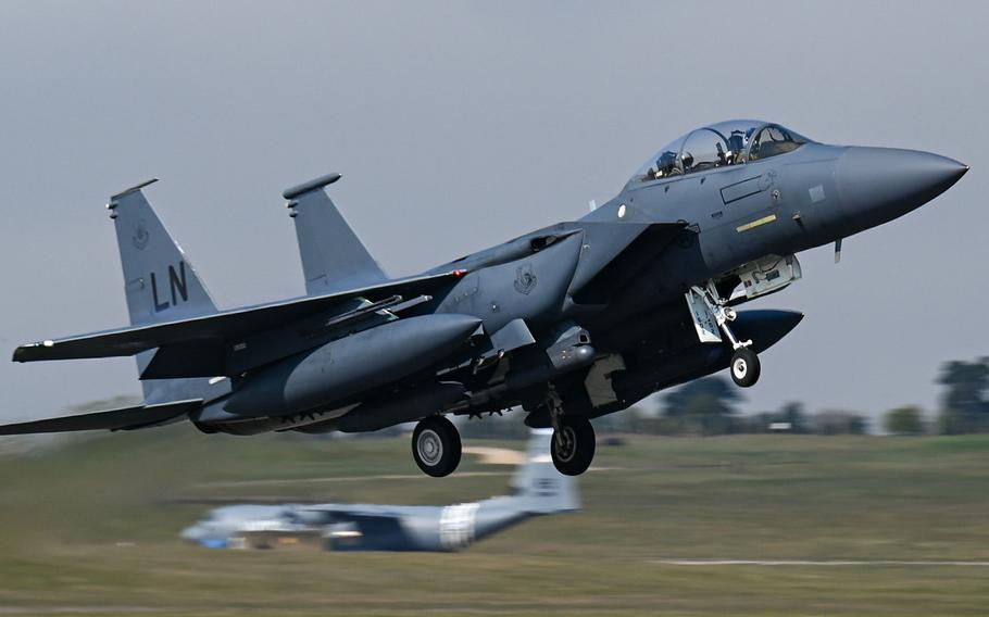 An F-15E Strike Eagle assigned to the 492nd Fighter Squadron takes off from RAF Lakenheath, England, April 19, 2021, for Poland, where U.S. airmen and aircraft are taking part in an agile combat employment exercise with the Polish air force.