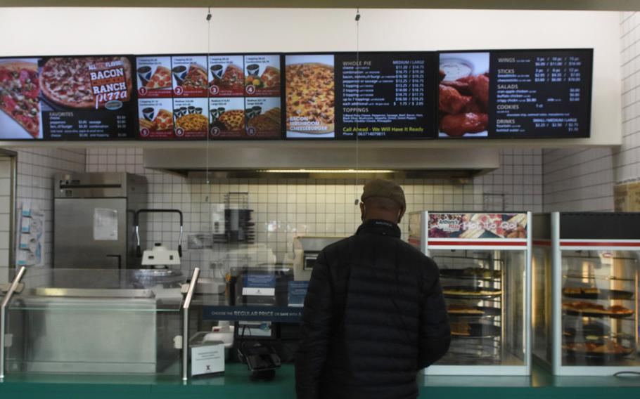 Marvin Mens orders lunch at Anthony's Pizza at Ramstein Air Base, Germany, on Wednesday, April 21, 2021. Mens said he chose Anthony's to avoid waiting in line. The Exchange pizzeria is the last Anthony's in Europe and will close May 1.