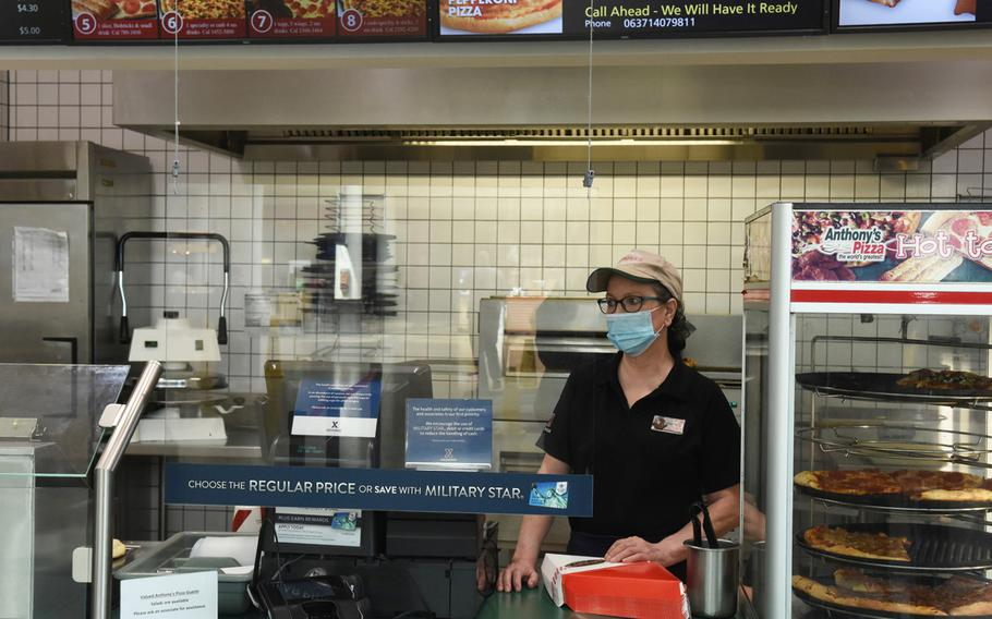 Gaby Zischke, a longtime worker at Anthony's Pizza, waits for customers on Wednesday, April 21, 2021, at Ramstein Air Base, Germany. The Ramstein location, the last in Europe, is closing at the end of the month.