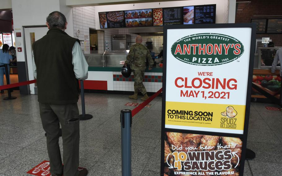 A few customers wait in line for lunch at Anthony's Pizza inside the food court at Ramstein Air Base, Germany, on Wednesday, April 21, 2021. The Exchange-brand pizzeria, which has dished out pizza for more than 30 years, is closing its last Europe location May 1.