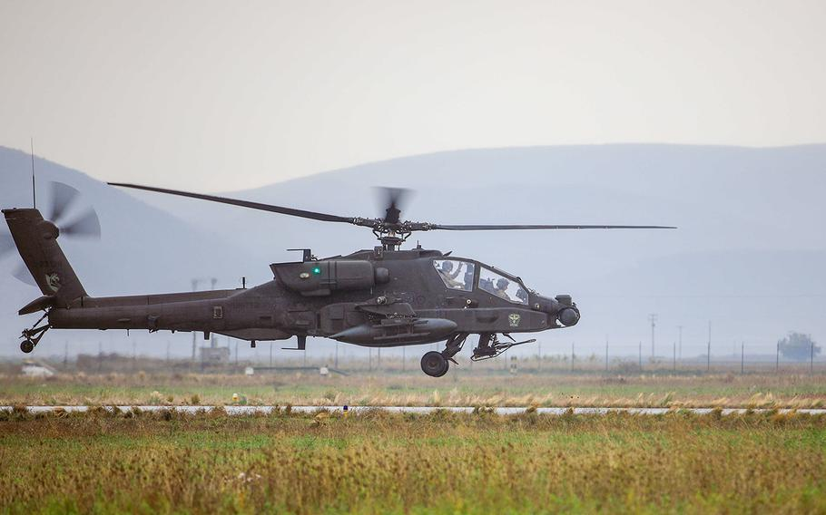 An AH-64E Apache helicopter assigned to 1st Battalion, 101st Combat Aviation Brigade, flies into Stefanovikeio Airfield, Greece, Nov. 10, 2020. About 40 members of the battalion went on an official trip in September to Gdansk, Poland, where several leaders went to an off-limits strip club and a major who was likely drugged went missing until the next day, an Army investigation found.