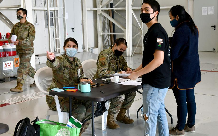 An airman assigned to the 31st Medical Group directs a person during a COVID-19 vaccination line at Aviano Air Base, Italy, April 23, 2021. The medical group administers Moderna vaccinations to U.S. personnel.