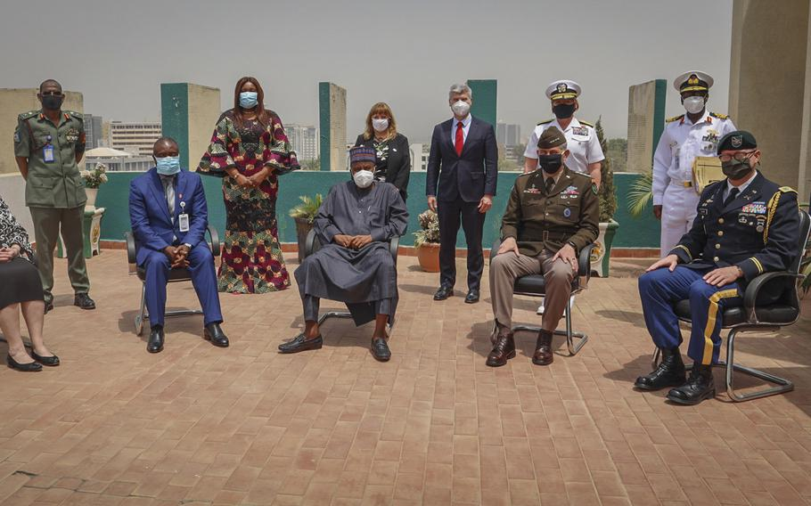 Army Gen. Stephen Townsend, head of U.S. Africa Command, seated second from right, poses with African leaders during a visit to Nigeria in February 2021. The country's president, Muhammadu Buhari, asked U.S. Secretary of State Antony Blinken during a virtual meeting April 27, 2021, to move U.S. Africa Command headquarters to Africa.