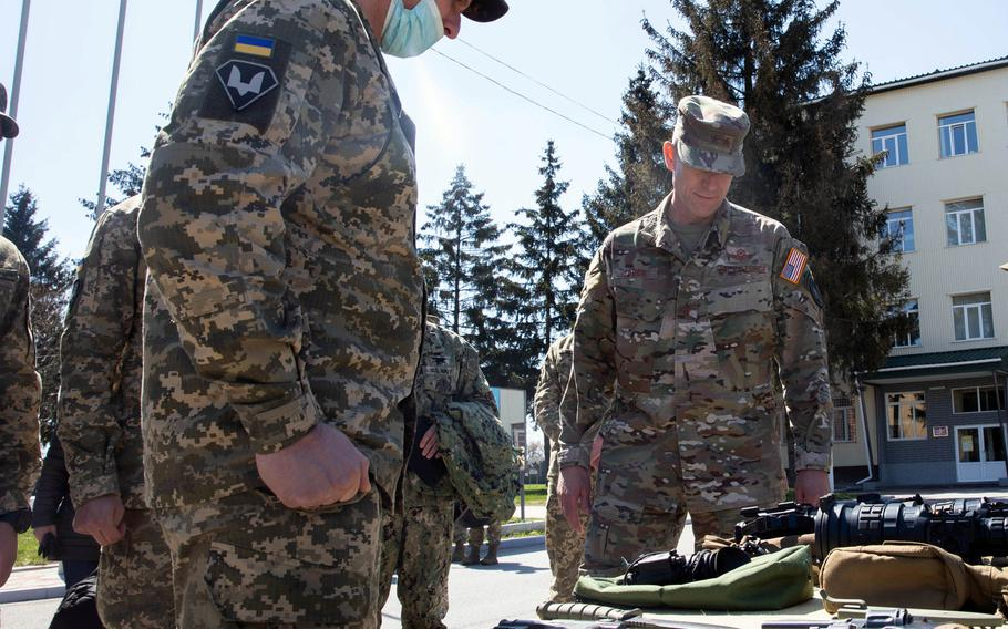 Maj. Gen. David Tabor, right, commander of  U.S. Special Operations Command Europe, receives a weapons briefing at the 142nd Training Center near Kyiv, Ukraine, April 28, 2021. Service members who train at the facility are familiarized with all weapons systems that they may encounter in the region.